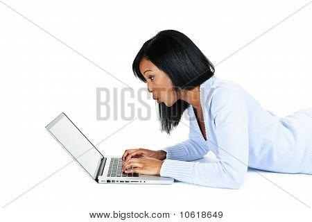 Surprised Woman Using Laptop Computer