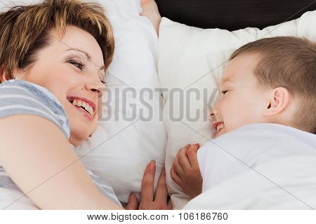 Mother and her son laying in bed