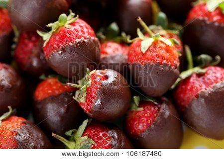 Fresh Strawberries Dipped In Dark Chocolate Background