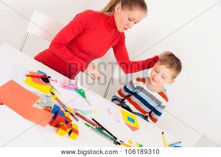 Mother praising her son for picture