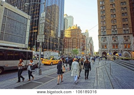 People Walk Along 6Th Avenue In New York City
