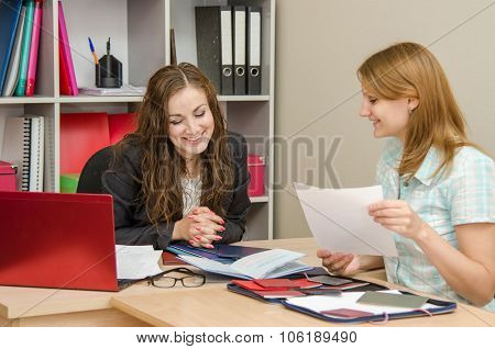 Young Girl And Specialist Personnel Conduct A Successful Interview