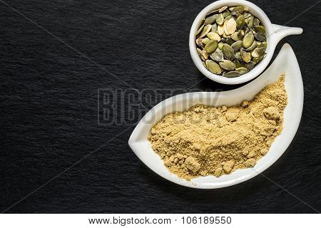 Pumpkin Seeds And Pumpkin Flour On The Surface Of The Shale