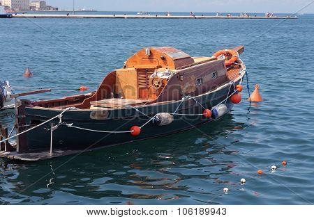 Old Wooden Boat In Harbor In Trieste, Italy
