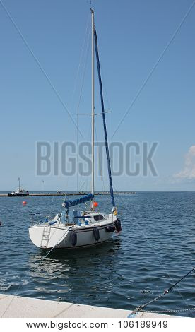 One Sailboat Moored In Harbor In Trieste,italy On Summer Day