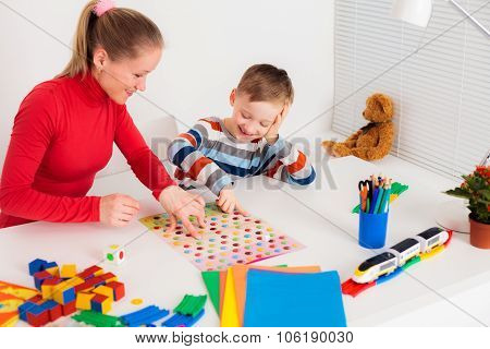 Preschooler boy playing in  board game