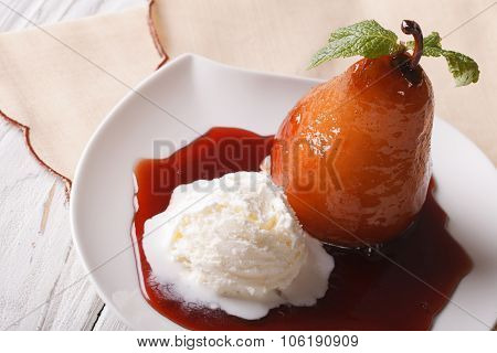 Pear In Wine Sauce With Vanilla Ice Cream Close-up. Horizontal Top View