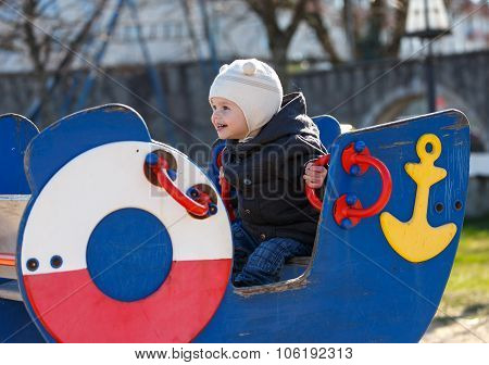 Young Captain On The Bridge Of His Toy Ship