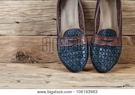 Women's Shoes On A Wooden Background Closeup