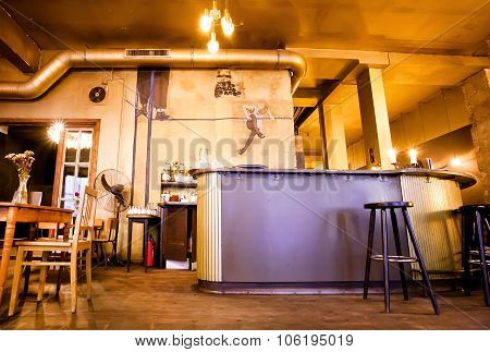 Empty Evening Bar Interior With Wooden Furniture