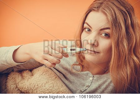 Sick Ill Woman With Digital Thermometer In Mouth.