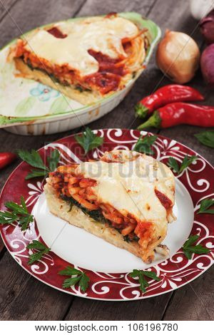 Pasticcio or pastitsio, baked pasta with cheese, chard and tomato sauce