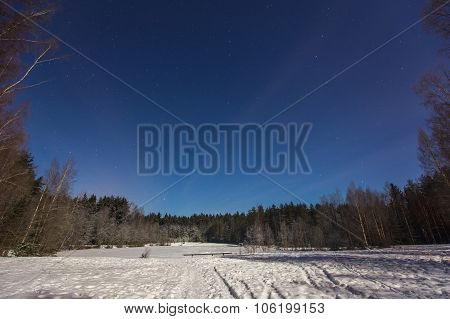 Frozen Winter Lake In Magic Moonlight At Night