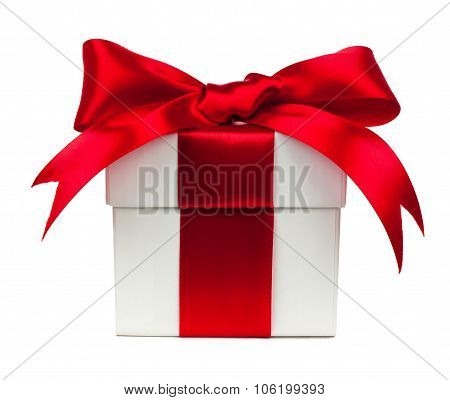 White gift box with red bow and ribbon over white