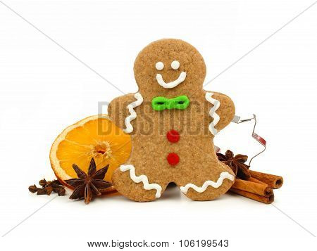 Christmas gingerbread man with holiday spices over white
