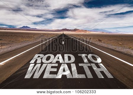 Road to Wealth written on desert road