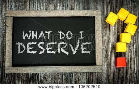 What Do I Deserve? written on chalkboard