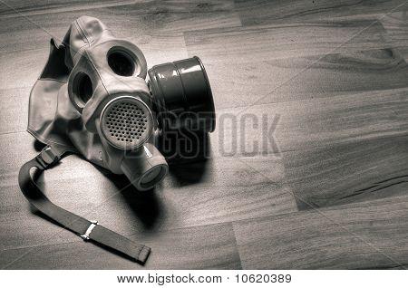 Gasmask On Wooden Floor