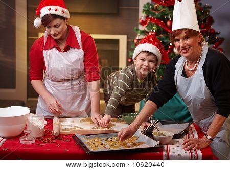 Grandmother, Mum And Son With Christmas Cake