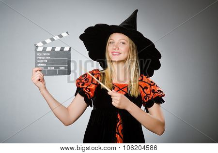 Witch with the movie clapboard