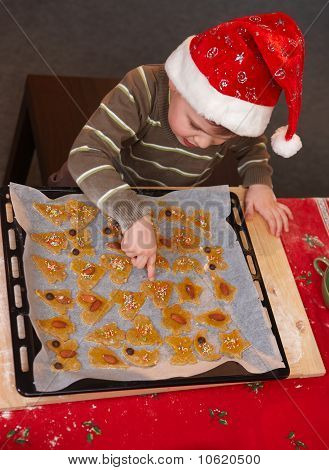 Small Boy Pointing At Christmas Cake