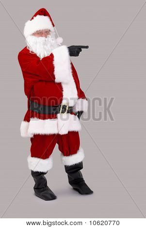 Santa Claus Pointing To Blank Space