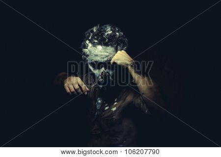 Expression, wild man with white painted face and full body black paint