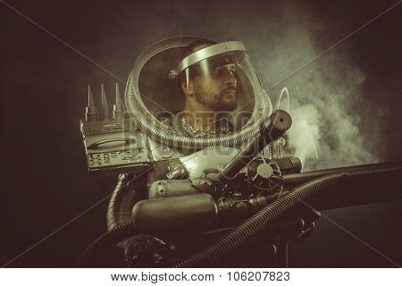 Pollution, spaceman with plasma gun and helmet glass