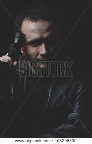 Depressed, Man with intent to commit suicide, gun and leather jacket, red backlight