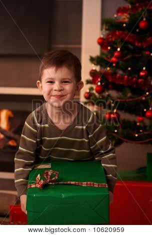 Happy Kid Holding Christmas Present