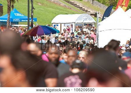 Large Crowd Of People Walks Through Atlanta Dogwood Festival