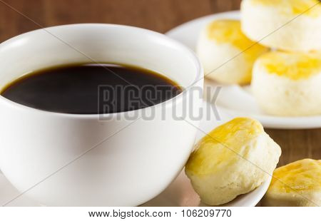 A Cup Of Coffee And Scone On Wood Background, Warm Toning, Selective Focus