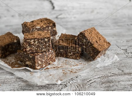 Chocolate Fudge With Cookies And Nuts On A Light Wooden Surface
