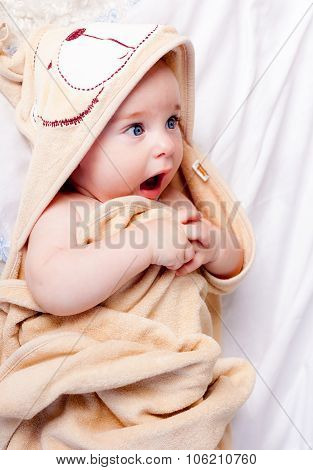 Cute baby boy wraping in towel