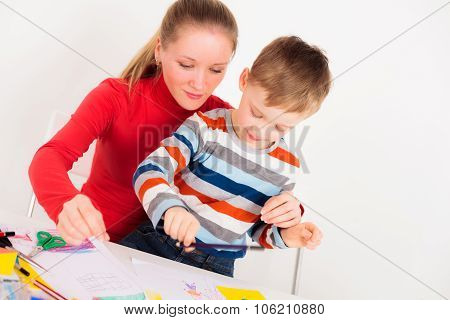 Mother drawing with her son