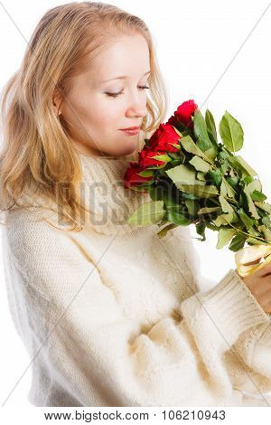 Beautiful woman  sitting with bouquet of red roses