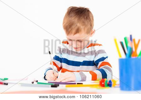 A little boy drawing a picture