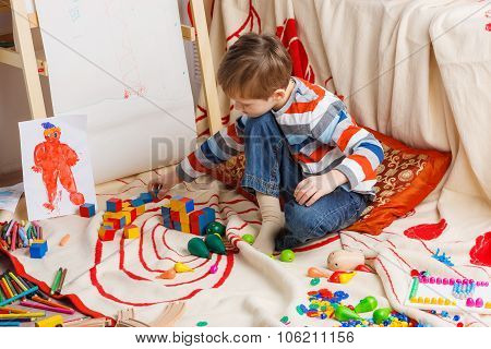 Preschool child playing with cubes