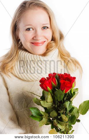 Pretty woman with bouquet of red roses