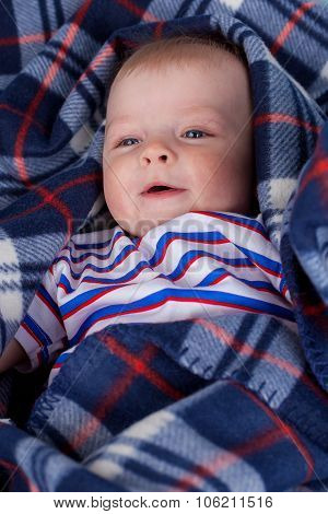 Cute baby wrapping in plaid