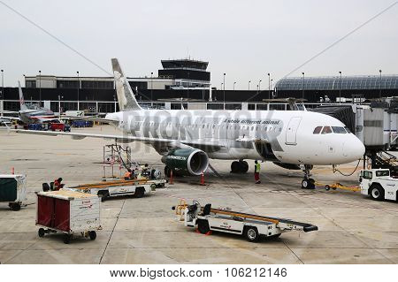 Frontier Airlines Airbus A320 plane at the gate at O'Hare International Airport in Chicago
