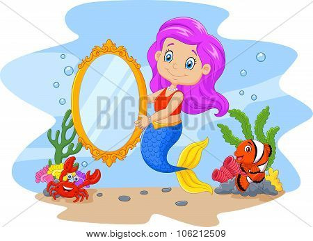 Cartoon funny mermaid holding a classic mirror with sea animal