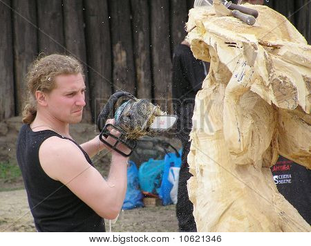 Master Works Above Creation Of Wooden Sculpture
