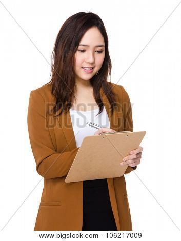 Young Buisnesswoman write on clipboard