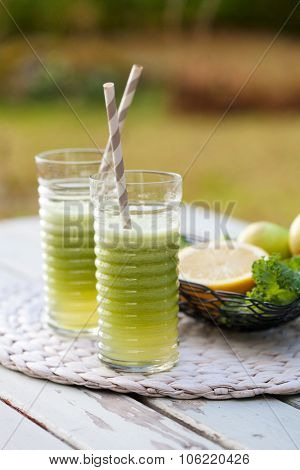 Homemade green juice made from fresh fruit and vegetable