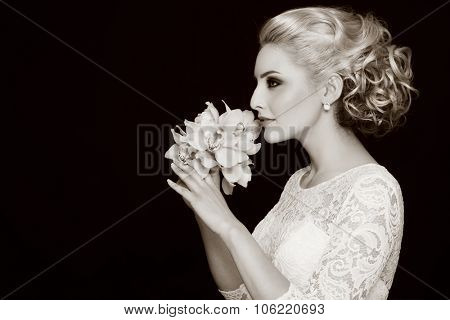 Duotone profile portrait of young beautiful bride with stylish prom hairdo