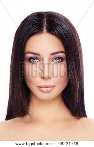 Portrait of young beautiful tanned woman with long straight hair and stylish make-up over white background