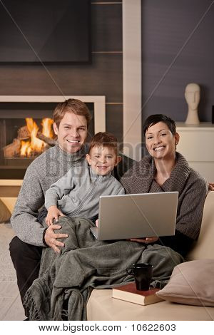 Happy Family With Computer