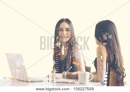 Asian business women talking to each other at business meeting room with laptop computer on office d