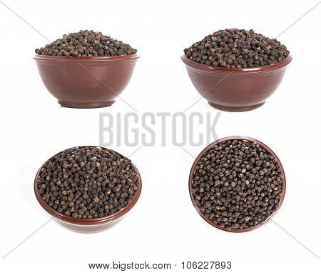 Black pepper isolated on a white background. Pepper in a plate on a white background. Pepper set.